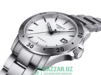 Мужские Швейцарские часы фирмы Tissot.